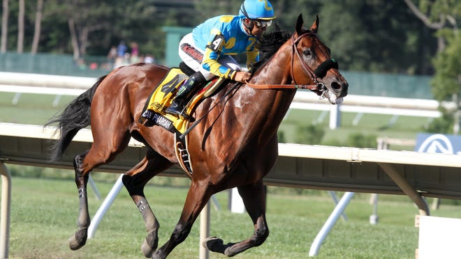 Will Triple Crown winner American Pharoah, shown here winning the Grade I, $1,750,000 William Hill Haskell Invitational at Monmouth Park on Aug. 2, be the top story of the year?