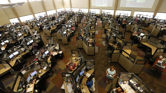 Employees in the HOMELINK division work Tuesday, Aug. 4, 2015, at VGM Group in Waterloo.