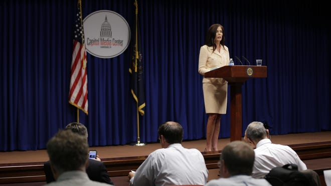 Pennsylvania Attorney General Kathleen Kane speaks during a news conference last week at the state Capitol in Harrisburg, Pa. Kane said Wednesday that criminal charges against her are part of an effort by state prosecutors and judges to conceal pornographic and racially insensitive emails they circulated with one another. Kane is charged with leaking grand jury information to a newspaper reporter as payback to a former state prosecutor and then lying about it under oath.