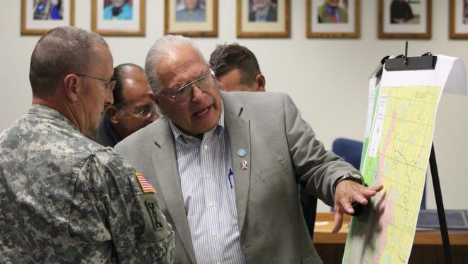 Blackfeet Tribal Committee Chairman Harry Barnes consults with National Guard Gen. Matt Quinn over deployment of firefighting resources.