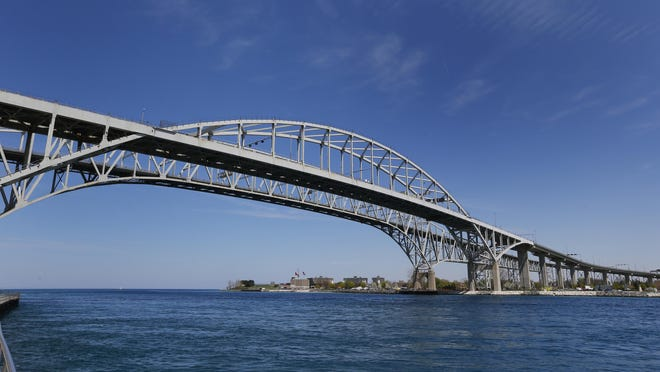 The Blue Water Bridge connecting Sarnia, Ontario to Port Huron, Mich., is shown Friday, May 15, 2015. The westbound span will be closed for resurfacing beginning in April and will reopen by July 1. All traffic will be diverted to the eastbound span. Both the Michigan portion and the Ontario portion of the bridge will be resurfaced. (AP Photo/Paul Sancya)