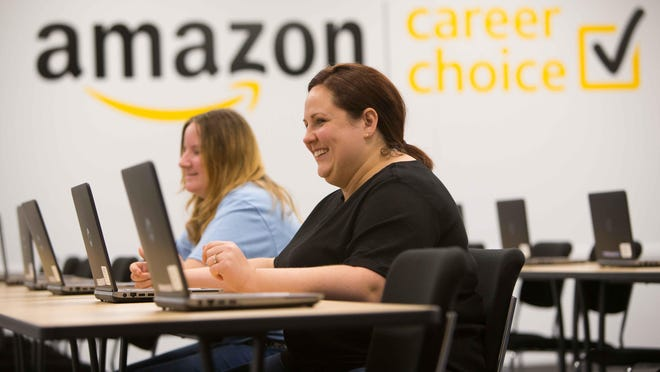 Middletown residents Lida Parag (right) and Alicia Nichols are taking a bookkeeping course taught by Delaware Technical Community College inside the Amazon facility in Middletown as part of the company's Career Choice program.