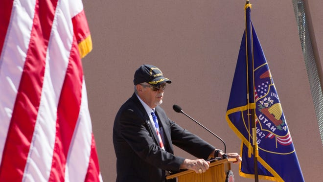 Navy Cmdr. Warren Jederberg speaks about the significance and impact the events of Sept. 11, 2001, had on America during the 9/11 Memorial Service that Dixie State University Student Association hosted Friday.