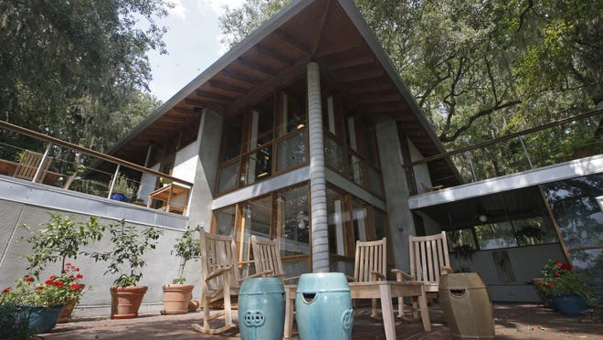 "Architect Rick Barnett built his Lake Jackson home in 1981 and renovated it in 2001-2002. The home recently was honored by the Florida Association of the American Institute of Architects with their ""Test of Time"" award, given to structures 25 years or older."