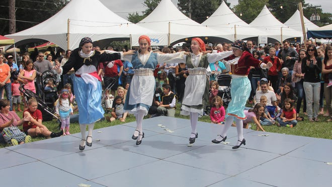 Youth dancers entertain the crowd at the Greek Food Festival Saturday
