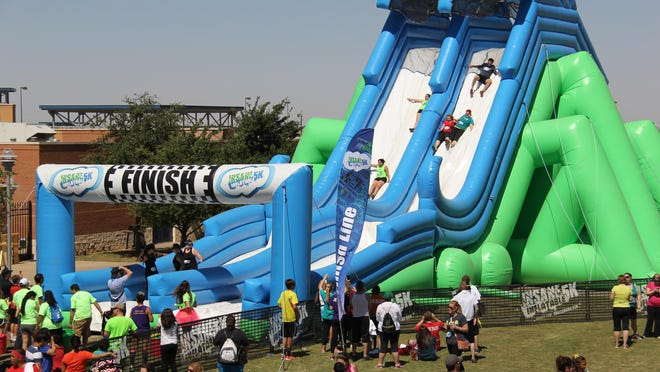 Runners finish the Insane Inflatable course during a 2014 race.