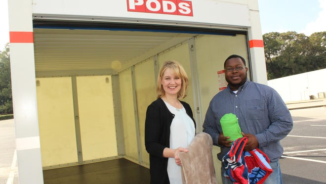 MACH Executive Director Molly Stone, left, and MACH outreach worker Donavon McGuire will be receiving blankets and warm clothing to help the needy this month.