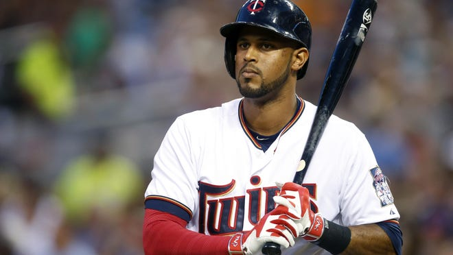 FILE - In this Sept. 15, 2015, file photo, Minnesota Twins' Aaron Hicks is on deck in a baseball game against the Detroit Tigers, in Minneapolis. New York Yankees general manager Brian Cashman is following through on his vow to start transforming the team quickly this offseason, acquiring switch-hitting outfielder Aaron Hicks from Minnesota for catcher John Ryan Murphy and dealing infielder Jose Pirela to San Diego. (AP Photo/Jim Mone, File)