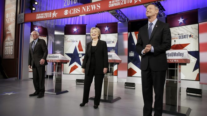 Democratic presidential candidates Bernie Sanders, left, Hillary Rodham Clinton and Martin O'Malley take the stage before a Democratic presidential primary debate Saturday in Des Moines, Iowa.
