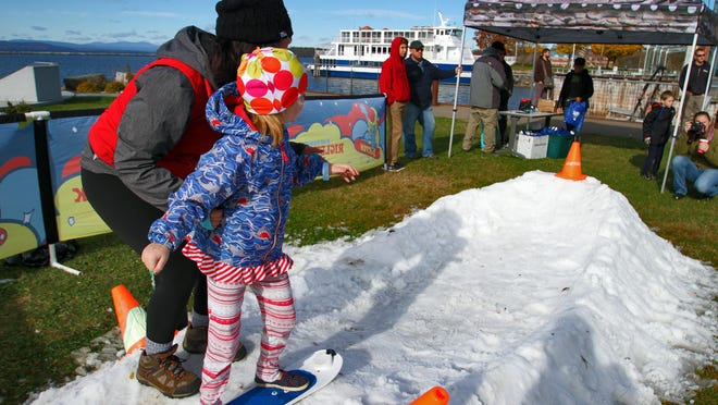 Young snowboarder gets guidance outside ECHO.