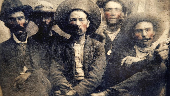 A blown up image created from a tintype which Dr. Michael Abrams believes is an original photograph of outlaw Billy the Kid, in the back, right corner of the print.