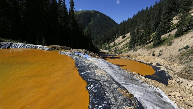 Water flows in August through a series of sediment retention ponds built to reduce heavy metal and chemical contaminants from the Gold King Mine wastewater accident, in the spillway about 1/4 mile downstream from the mine, outside Silverton.
