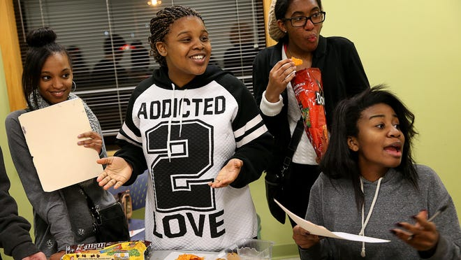 A group of Warren Central High School students debate a fellow student's punishment during a Reach for Youth teen court session at the Warren Township Government Center on Dec. 17.
