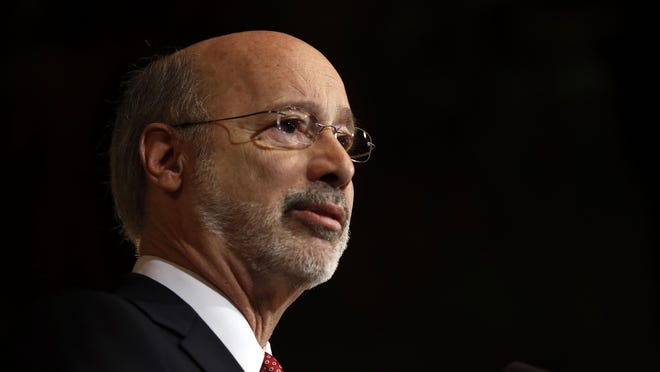 Pennsylvania Gov. Tom Wolf speaks with members of the media Tuesday, Dec. 29, 2015, at the state Capitol in Harrisburg, Pa. Wolf said he is rejecting parts of a $30.3 billion state budget plan that's already a record six months overdue, but he's freeing up over $23 billion in emergency funding. (AP Photo/Matt Rourke)