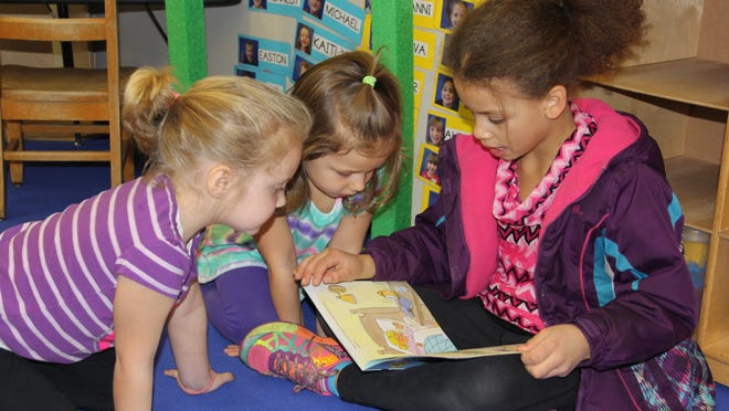 Photo caption: Third-grader Savannah Henson reads to UPK students Zoey Hoyt and Layla McKee. provided by BCSD
