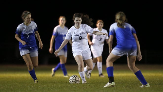 Maclay freshman Katie Lynch kicks the ball past multiple Rocky Bayou defenders during their District 1-1A final at Maclay School on Friday. Lynch scored the game's first goal in a 2-1 win.