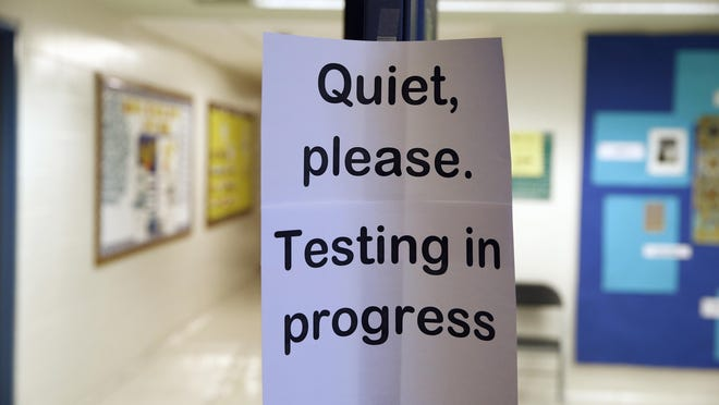 In this photo taken Jan. 17, a sign is seen at the entrance to a hall for a college test preparation class at Holton Arms School. The current version of the SAT college entrance exam is having its final run, when thousands of students nationwide will sit, squirm or stress through the nearly four-hour reading, writing and math test. A new revamped version debuts in March.