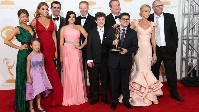 9/22/13 8:29:49 PM -- Los Angeles, CA, U.S.A  --   The cast of Modern Family poses in the photo room at the 2013 Emmy Awards at the Nokia Theater in Los Angeles, CA.   Photo by Dan MacMedan, USA TODAY contract photographer  ORG XMIT:  DM 130152 2013 EMMYS 9/19/2013 (Via OlyDrop)