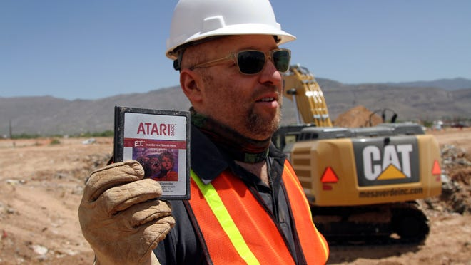 Film Director Zak Penn shows a box of a decades-old Atari 'E.T. the Extra-Terrestrial' game found in a dumpsite in Alamogordo, N.M., Saturday, April 26, 2014. Producers of a documentary dug in a southeastern New Mexico landfill in search of millions of cartridges of the game that has been called the worst game in the history of video gaming and were buried there in 1983. (AP Photo/Juan Carlos Llorca) ORG XMIT: RPJL205