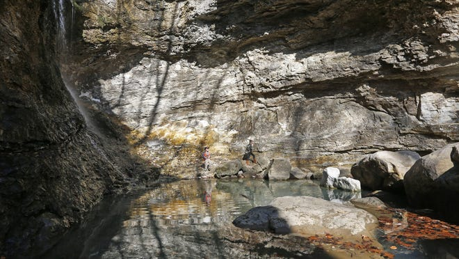 Aaron Reed, 8, and his sister Makayla, 5, both of Green Forest, Arkansas, explore Eden Falls on the Lost Valley hiking trail on Saturday, Feb. 6, 2016.