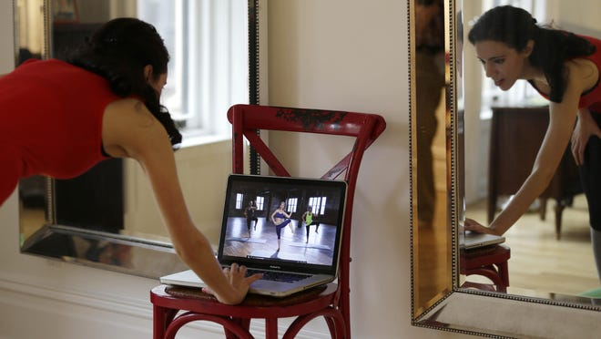 Christina Macchiarola demonstrates how she uses the Crunch Live fitness app to work out in her apartment in New York.