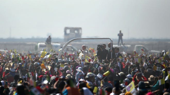 Pope Francis rides on a popemobile as he makes his way through pilgrims waiting for mass in Ecatepec, Mexico, on Sunday. It is to be his biggest event during his trip to Mexico.