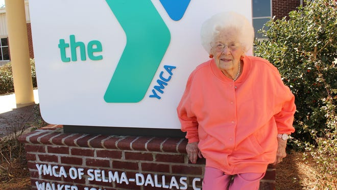 "Mallieve Breeding, known as ""Madame Butterfly"" in Selma, enjoys the sunshine outside the Selma-Dallas County YMCA. Breeding died on March 15 at the age of 96."
