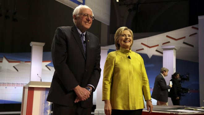 Democratic presidential candidates Bernie Sanders and Hillary Clinton take the stage before a debate Feb. 11 at the University of Wisconsin in Milwaukee.