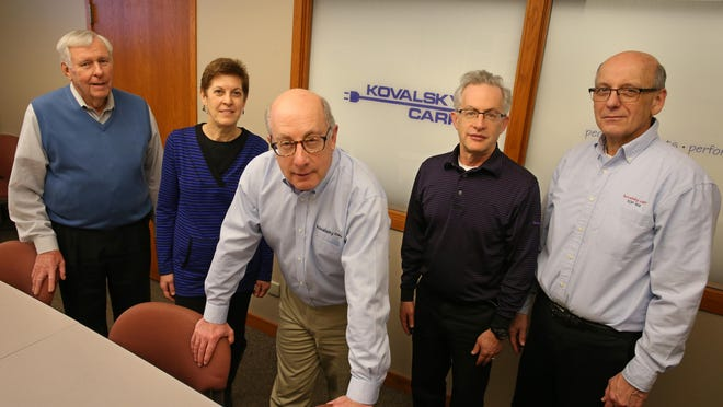 Arnold Kovalsky, President, center, poses with the management team at Kovalsky Carr Electric Supply Company in downtown Rochester Thursday, Feb. 25, 2016. Pictured from left are, Don Bausch, VP Marketing, Karen White, Officer Manger / Accounting Manager, Arnold Kovalsky, Laurence Kovalsky, Vice President, and Jerry Turner, Vice President Operations and Technology.