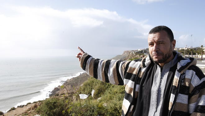 Younis Chekkouri gestures toward the Atlantic Ocean as he speaks to Associated Press Feb. 15 in Safi, Morocco. Chekkouri was released from Guantanamo after 13 years without charges, and is free in his home country for the first time in two decades.