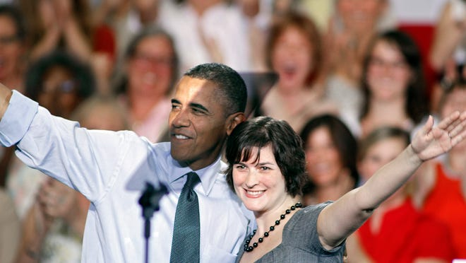 DENVER, CO - AUGUST 8:  Sandra Fluke gets a hug from U.S. President Barack Obama after introducing him to speak during a campaign stop at the Auraria Events Center August 8, 2012 in Denver, Colorado. Fluke is the Georgetown Law Student who testified before Congress earlier this year in favor of insurance coverage of contraception. Obama spoke about the economy and how he says Obamacare has helped women and their access to healthcare. (Photo by Marc Piscotty/Getty Images) ORG XMIT: 149999431 ORIG FILE ID: 150007728