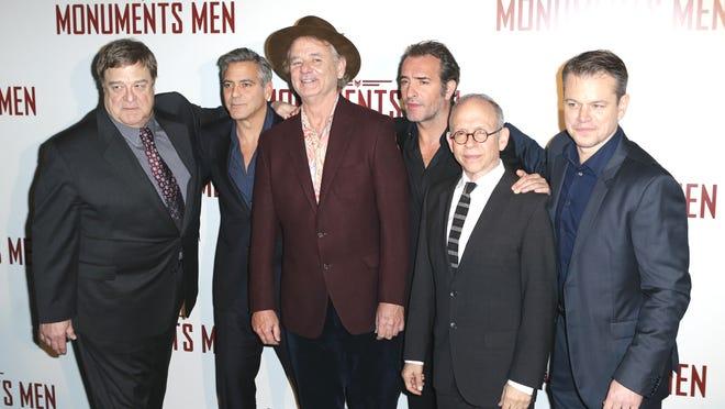 "From left, actors  John Goodman, George Clooney, Bill Murray, Jean Dujardin, Bob Balaban and Matt Damon at the French premiere of ""Monuments Men."""