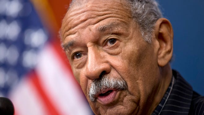 FILE - In this July 30, 2013 file photo, U.S. Rep. John Conyers, D-Detroit, speaks at a news conference on Capitol Hill in Washington. On Tuesday, April 29, 2014, Democratic challenger the Rev. Horace Sheffield III challenged Conyersí nominating petitions for the Aug. 5 Democratic primary. That followed a WDIV-TV report that two of the petition circulators were not registered to vote at the time that they gathered the signatures. If the petitions are disqualified and Conyers falls short of the 1,000 valid signatures needed, his name would not appear on the ballot. Conyers first was elected to Congress in 1964. (AP Photo/J. Scott Applewhite, File) ORG XMIT: NYPS202