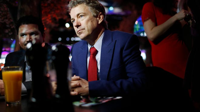 U.S. Sen. Rand Paul, R-Ky., speaks with people at the Peppermill restaurant Friday, Jan. 16, 2015, in Las Vegas. Paul is a possible Republican presidential candidate. (AP Photo/John Locher) ORG XMIT: NVJL104