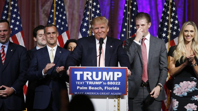 Republican presidential candidate Donald Trump speaks to supporters at his primary election night event at his Mar-a-Lago Club in Palm Beach, Fla., Tuesday, March 15, 2016. Right is his son Eric Trump and second left is his campaign manager Corey Lewandowski.