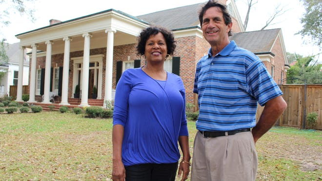 Sharon Jackson and Selma Councilman Greg Bjelke stand in the front yard of the Converse-Jackson house that will be on display at the Selma Pilgrimage Friday and Saturday.