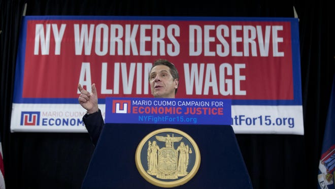 Gov. Andrew Cuomo during a recent rally to raise the minimum wage.