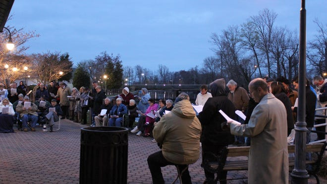 Worshipers gathered along the waterfront in Joseph Buck Park on Sunday to celebrate Easter.