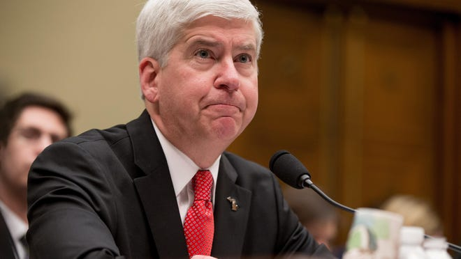 Michigan Gov. Rick Snyder pauses while testifying before a House Oversight and Government Reform Committee hearing in Washington, Thursday, March 17, 2016, to look into the circumstances surrounding high levels of lead found in many residents' tap water in Flint, Michigan. (AP Photo/Andrew Harnik)