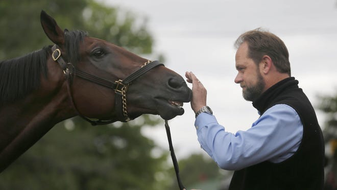 Trainer Doug O'Neill with Kentucky Derby works with favorite Nyquist after Kentucky Derby workouts earlier this week at Churchill Downs. O'Neill is focused on this horse, not his past problems.