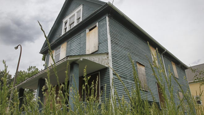 """A boarded up house on N. Union St. in Rochester is one of dozens of """"zombie"""" properties in the city."""