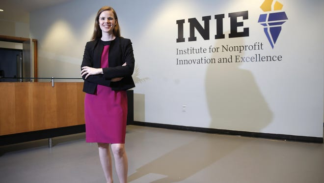 Jessica Lowe-Minor, Director of the Institute for Nonprofit Innovation and Excellence stands inside INIE's new permanent home, on the third floor of TCC's Capitol Center downtown.