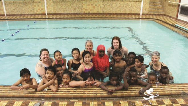 A class of New Americans from the Integrated Arts Academy wrap up a recent week-long series of swim lessons at the Greater Burlington YMCA.