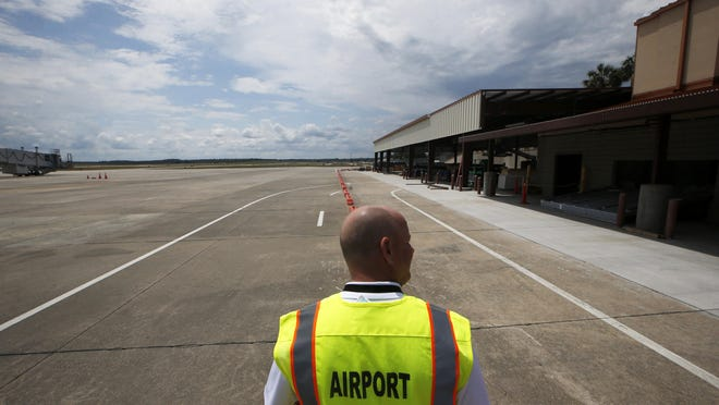 David Pollard, Superintendent of Operations, walks the grounds at Tallahassee International Airport where renovations are underway.