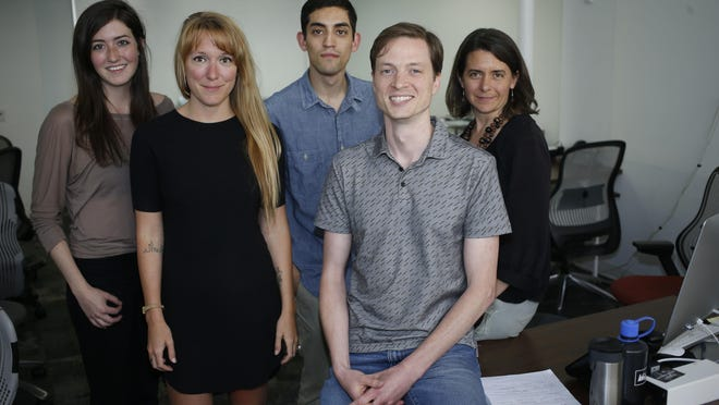 Members of the Denverite, a news startup based in Denver, are seen in the venture's office. Editor Dave Burdick, front, is flanked by some of the site's co-workers, from left, Chloe Aiello, Ashley Dean, Adrian Garcia and Erica Meltzer.