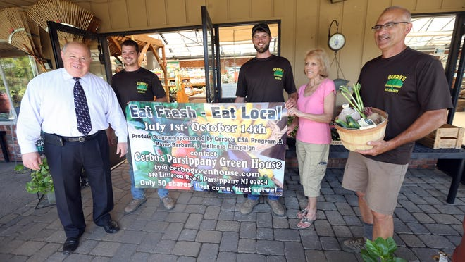 Parsippany Mayor James Barberio, l, Tyler Cerbo, Anthony Cerbo IV, Cindy Cooper and Tony Cerbo announce a community supported agriculture program launched in Parsippany at Cerbo's Greenhouse, a 100+ year old business. June 30, 2016, Parsippany, NJ