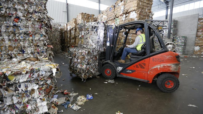 Recycled items go to the Rumpke Recycling facility in St. Bernard where they are sorted and then bailed for export.