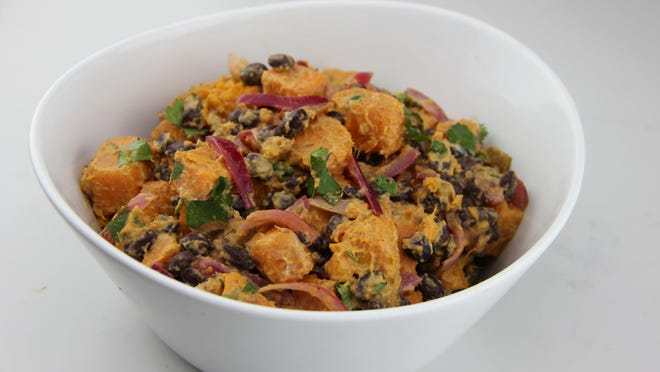 Black beans are paired with American-grown sweet potatoes, a red-wine vinegar and red onion vinaigrette and a touch of smoky mayo-based dressing.