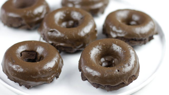 Chocolate peanut butter baked doughnuts are baked in the oven.