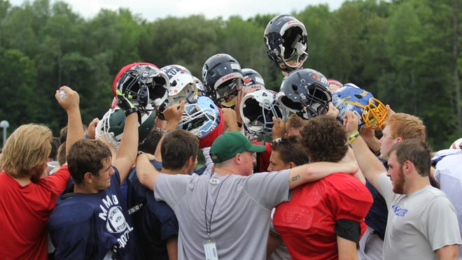 Vermont huddles during a practice at Castleton University prior to Saturday's Shrine Maple Sugar Bowl.